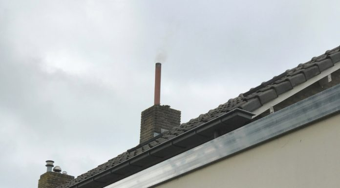 luchtvervuiling houtstoker Bruin Driek van Erpstraat 23 Oss